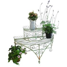 This 3-tier plant and flower etagere is an intriguing display for your favourite blooms, featuring trellis and scrollwork detailing.