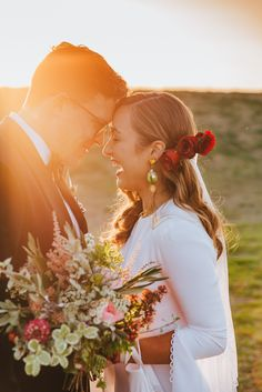 TOAST WEDDINGS| Photography | Sunset Wedding|   Giggles at sunset with Tarah, stunning wedding bouquet and dress sleeves.
