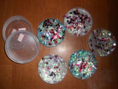 Sun catcher! Materials:  Pringles plastic lids  sequins or dazzles  white glue    Directions:  Fill the Pringles lid with white glue.  Cover with colorful sequins or dazzles. Allow to dry for several days.  Peel out from the lid. Cut into shapes or use as is.