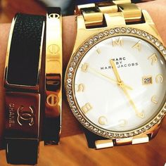 That's one happy wrist.  Don't like the stones around the timepiece, but love everything else about this look...