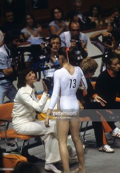 Rear view of Romania Nadia Comaneci victorious during Women's competition at Montreal Forum. Montreal, Canada 7/18/1976 - 7/19/1976 Heinz Kluetmeier X20682 TK0 R84 F16 )