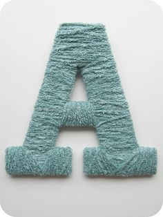 Yarn wrapped letters: Print out letters for template (Rockwell, bold), trace and cut out on foam board, wrap in yarn. Use glue gun to hold yarn in place. Hot glue picture hanger on back.