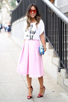 Best #streetstyle @ Spring 2015 Ready-to-Wear #NYFW | Aimee Song in a white graphic tee paired with a pink flared midi skirt, berry ankle strap sandals and a blue box clutch