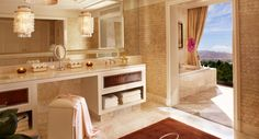 Encore Las Vegas Two Bedroom Apartment at 3,475-square feet. Living areas feature corner view windows, making this retreat perfect for both entertaining and private receptions. Each bathroom features a steam shower, whirlpool deep-soak tub, dual sinks, separate water closet and bidet.