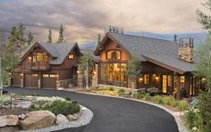 Timber Frame Home.  Like balcony over garage and use of rock and wood exterior