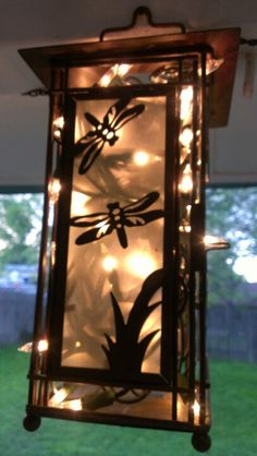 My Dragonfly Lanterns with Christmas lights stuffed inside. -SP