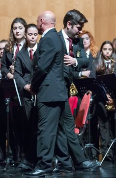 https://flic.kr/p/BjfXmm | Passing the baton | The band's regular director, Diego Carrillo Soler passed the baton to Joaquin Grau Murcia for the first part of the programme last night.   Joaquin, who was born in Bigastro, is a teacher of music and director of the Real Conseratorio Superior de Musica de Madrid along with several other well known bands and orchestras.   Clearly a child prodigy, he first joined the band at the age of 7!