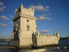 Belém Tower is a fortified tower located in the civil parish of Santa Maria de Belém in the municipality of Lisbon, Portugal. Las Azores, Destinations, Travel Tours, Travel Guide, Beach Trip, Beach Travel, World Heritage Sites, Tower Bridge, Luxury Travel