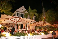 THE GRAND CAFE IS A WARM AND INVITING FAMILY OWNED RESTAURANT IN KEY WEST. LOCATED IN A BREATHTAKING VICTORIAN MANSION THE GRAND CAFE SERVES FINE WINES, PERFECT MARTINIS, AND OF COURSE DELICOUS SEAFOOD AND MEATS. YOU ARE INVITED TO SPEND A LAZY AFTERNOON HAVING LUCH IN OUR GARDEN, TAKE YOUR TIME WITH STARLIT MEALS ON OUR WRAPAROUND PORCH, AND ENJOY OUR NEWLY RENOVATED BAR AND LOUNGE.