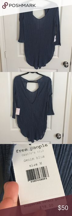 Free People NWT tunic in denim blue size medium Awesome lightweight tunic by Free People. NEW with TAGS originally $78. Size medium and true to size, with a stretchy fit. Low, slight open back and sides. Free People Tops Tunics