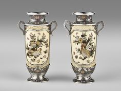Japanese pair of silver and enamel vases