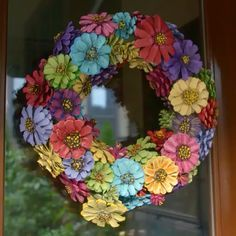 This is not your grandmother's pinecone craft! Gather up some pinecones and your favorite spray paint colors for a durable, bright wreath that will dress up your door for any season! #EasyDoesIt