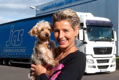 Harmony Fund helps truck driver Tamara Raab make a 2,000 mile round-trip to Romania that will bring dog and cat food, veterinary supplies, and beds to local shelter.