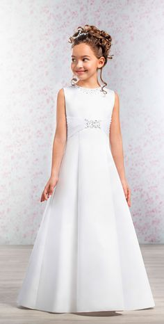 From the Emmerling 2017 First Communion Dress Collection. A classic A line satin First Communion Dress with a modern twist. The neckline is adorned with sparkly sequins and beading and the bodice has a high pleated waistband with central bead and sequin motif. Plus sizes are available on special request - please contact us to order.