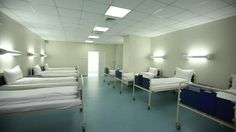 Empty Hospital Room Showing Beds  #videohive