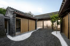 Good wood - Beijing based Arch Studio renovated a traditional courtyard house in the Chinese capital, adding grey-brick paving that flows from the floor of the outdoor space to form internal walls and. Chinese Courtyard, Brick Paving, Courtyard House, Space Architecture, Futuristic Architecture, Design Furniture, Traditional House, Traditional Chinese, Interior And Exterior