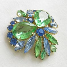 Vintage JULIANA Style Shades of Blue Rhinestones & Green Cut Glass Brooch by MyVintageJewels on Etsy