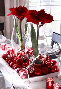 Holiday Centerpieces   Amaryllis in Hurricanes on a tray surrounded by Ornaments