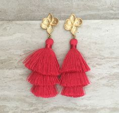 $24.99 The ultimate tassel statement earrings. Lightweight & Gorgeous   Featuring:- Three tiered red silk tassels total length 3 connected to a 24K matt gold plated floral feature 925 sterling silver ear post and back  More earrings click here :- https://www.etsy.com/shop/handmadedezigns?ref=seller-platform-mcnav&section_id=11412217   Custom Orders Welcome. For Wholesale please message me through Etsy    We offer Worldwide Fedex Express Shipping on all order
