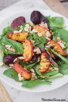 Grilled Peach Salad   Only 144 Calories   Sweet & Savory   Perfect way to get crunch, fiber & nutrients   For MORE RECIPES, fitness & nutrition tips please SIGN UP for our FREE NEWSLETTER www.NutritionTwins.com