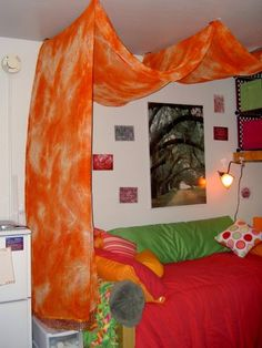 Dorm room...this fun canopy was hung with 3M removable hooks attached to ceiling. Clear fishline was then used and the fabric was draped over it. Removable velcro was also used to secure it further.