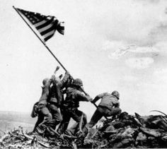 The flag raising at Iwo Jima was the defining image of the Pacific theater of World War 2. The American Marines and a Navy corpsman were snapped atop Mount Suribachi, hoisting their flag after wresting Iwo Jima from the Japanese.