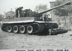 A personal photo showing American soldiers inspecting and posing with a Tiger 1 abandoned in Italy during 1944.