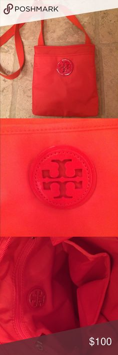 Tory Burch Handbag NWOT. Authentic. Orange/Coral color. Never been used. Received as a Christmas present, just not my color! Tory Burch Bags