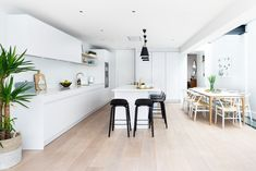 This dreamy white kitchen diner provides a modern, clean and minimalistic feel for your home.   Kitchen by Elan Kitchens - London 55 New King's Road, London, SW6 4SE www.elankitchens.co.uk Fulham, Modern Kitchens, Minimalist, London, Table, Furniture, Home Decor, Decoration Home, Room Decor