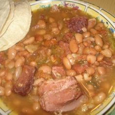 """This is an authentic recipe right out of Mexico """"Frijoles Charros"""" Mexican Cowboy Beans, These beans are delicious you can eat them right out of the bowl with hot buttered tortillas, and some hot salsa. Yum Yum. They are a meal by themselves. They cook for about 5/6 hours but the time is well worth it. You can serve along side Mexican rice, and add some Pico De gallo or Salsa with the tortillas. You need not make any meat dish with the Charro beans as they are loaded with meat. Delicious…"""
