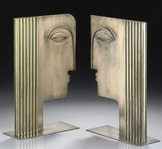FRANZ HAGENAUER / PAIR OF SILVERED-BRASS HEADS / CIRCA 1950 / fashioned as a stylized male and female in profile, both with angular features, the applied haircuts from hollow cylindrical tubes / stamped maker's marks with MADE IN AUSTRIA