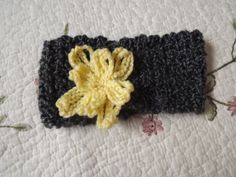 Ready to ship Hand crocheted headband Dark grey by WillowPrairie, $15.00 This headband is perfect for keeping your ears warm on a chilly spring day while adding pop to your wardrobe.  Size: adult small Fiber: 98% acrylic 2% polyester Color: Dark grey with yellow flower  Machine wash and dry