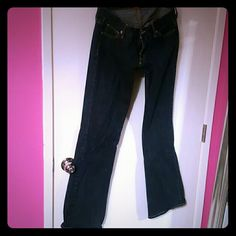 Dark jeans Size 29 but taken in at the waist. Dark wash Guess Jeans Flare & Wide Leg