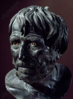Bronze head known as Seneca, artefact uncovered in Villa dei Pisoni (Villa of the Papyri), Herculaneum, Campania, Italy. Roman Civilisation, 1st century. Naples, Museo Archeologico Nazionale (Archaeological Museum)