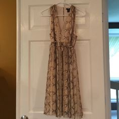 Soft & Flowy H&M dress! Animal print very soft and flowy dress worn once!  Great dress! H&M Dresses Mini