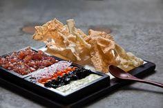 Tuna tartar with shallot and kizame wasabi served with cooked seaweed, homemade wasabi mayonnaise, pickled vegetable, radish and homemade rice crackers