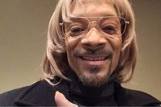 Snoop Dogg isnt Snoop Dogg anymore, now hes white guy Todd. Snoop has transformed himself into Todd by painting his face white and wearing a blonde wig.