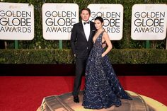 "Hollywood's favorite couple Channing Tatum and Jenna Dewan Tatum looked like the perfect match on the red carpet at the 73rd Annual Golden Globe Awards on Jan. 10, 2016. Jenna, who donned a stunning navy embellished  Zuhair Murad Couture dress, supported her husband whose movie ""The Hateful Eight"" has been nominated for three awards."