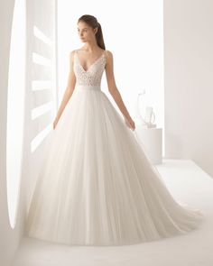 Princess-style beaded lace and tulle wedding dress with V-neckline, sheer inserts and full skirt, | Wedding Attire| Wedding Dresses | Weddings | Bride | #weddings #attire #bride #groom #dresses #weddings | www.starlettadesigns.com/