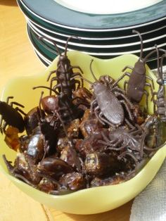 """Cream Cheese Stuffed Roaches...These gross-looking Halloween treats are actually delicious dates, filled with cream cheese and chopped walnuts. For an extra touch, place the """"Stuffed Cockroaches"""" in a bowl, or scatter them over a platter, alongside similarly sized rubber cockroaches, to make the dessert even spookier."""