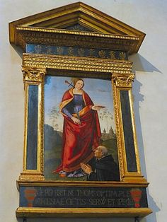 Saint Lucy in a tabernacle frame.