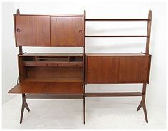 Danish teak free standing wall unit, circa 1950s. Available from The ModHaus.