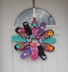 """Flip Flop Butterfly Sun Fun, Decorate your door or room with the summer footwear we love to wear. This wreath is fastened with greening pins making it sturdy and heat resistant. The wreath measures approximately 22"""" across, includes 12 flip flops and comes with a variety of flower embellishment's and rhinestones. Please avoid displaying this wreath in between a storm and house door. Too much direct sunlight causes extreme heat built up."""