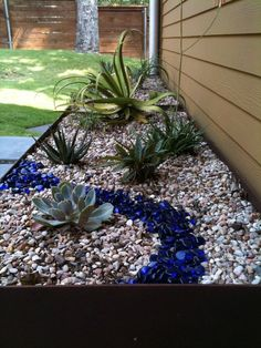 planter with succulents, river rock and blue glass. Glass mulch for gardens, fire pits, landscaping More 44 Beautiful Ideas For Backyard Landscaping On A Budget For You Garden Edging: Landscape Edging Ideas with Recycled Materials River Rock Landscaping, Small Front Yard Landscaping, Succulent Landscaping, Landscaping With Rocks, Succulents Garden, Backyard Landscaping, Landscaping Ideas, Decorative Rock Landscaping, Modern Backyard