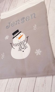 silver, white and grey Snow man.