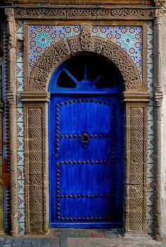Moorish style tiled blue door.