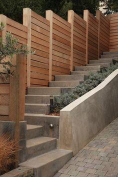 sand blasted color concrete, cedar fencing