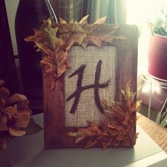 Total cost $1.40 to make. I bought the Wood frame from walmart. I painted it brown and took harvest orange paint using a scotch brite pad distressed the orange into the brown. Then cut a strip of burlap glued it to some cardboard and painted an H on it. Embellished it with some leftover leaves from another craft and done! So simple yet so cute!!!