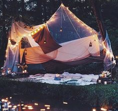 Night time picnic with fairy lights and candles