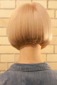 Beautifully-bevelled edges and clipper-tidied nape to this slightest of graduated bobs.
